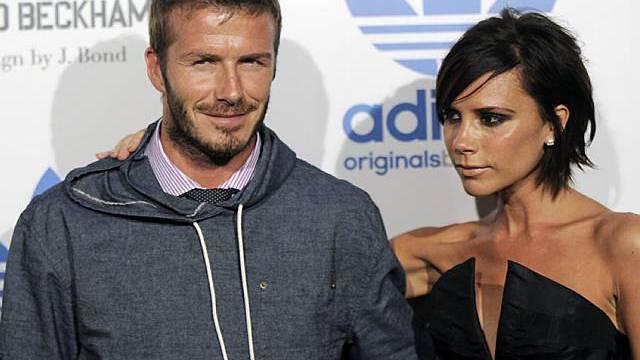 Vicoria und David Beckham (Archiv) erwarten im Sommer ein Mädchen.