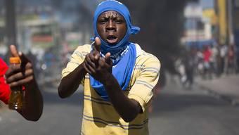 Viel Wut bricht sich Bahn in der haitianischen Hauptstadt Port-au-Prince.