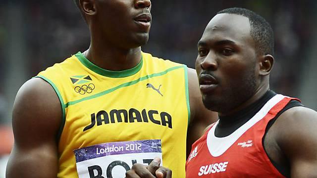 Alex Wilson beim Handshake mit Superstar Usain Bolt