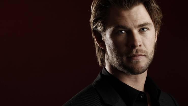 Der australische Schauspieler Chris Hemsworth findet es schön, an Ausserirdische zu glauben. (Archivbild)