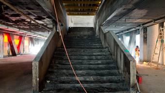 Die grosse Zerstörung im riesigen Campus-Neubau an den Holzböden, Treppen, Wänden und Decken. Emanuel Per Freudiger
