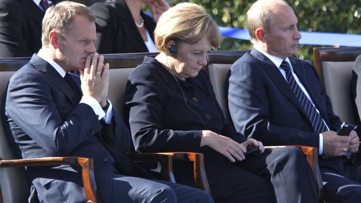 Der polnische Premierminister Donald Tusk, die deutsche Bundeskanzlerin Angela Merkel und der russische Premierminister Wladimir Putin.