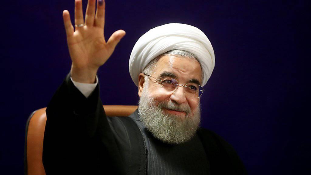 Irans Präsident Ruhani ist zufrieden mit der Aufhebung der Sanktionen (Archiv)