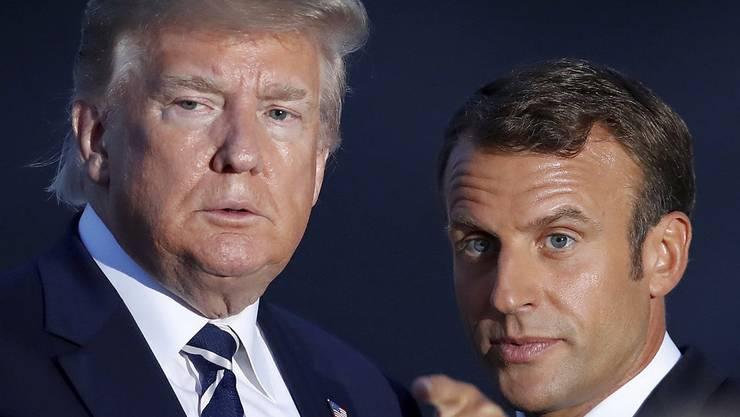 Beide wollen der Schweiz ihren Kampfjet verkaufen: Emanuel Macron (rechts) und Donald Trump.