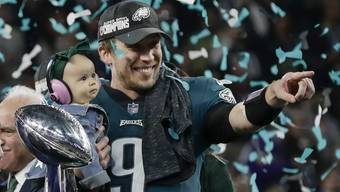 Philadelphia Eagles' Nick Foles holds his daughter, Lily, after beating the New England Patriots in the NFL Super Bowl 52 football game Sunday, Feb. 4, 2018, in Minneapolis. (AP Photo/Frank Franklin II)