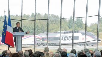 Milliardenprojekt: Frankreichs Präsident Nicolas Sarkozy bei der Einweihung der neuen TGV-Linie.  KEY