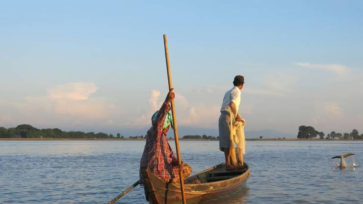 Myanmar Fischer mit Irawadidelfin