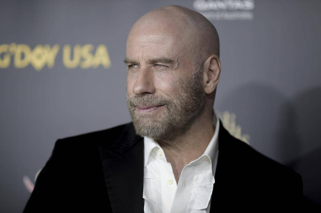John Travolta: «Das Leben mit Glatze ist einfacher» (© Keystone)