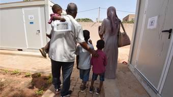 Eine Flüchtlings-Familie am UNHCR-Hotspot in Niamey, Niger.
