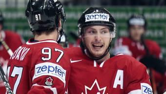 Weltmeister-Torschütze: Kanadas Connor McDavid (re.) freut sich über das Siegtor im WM-Final gegen Finnland
