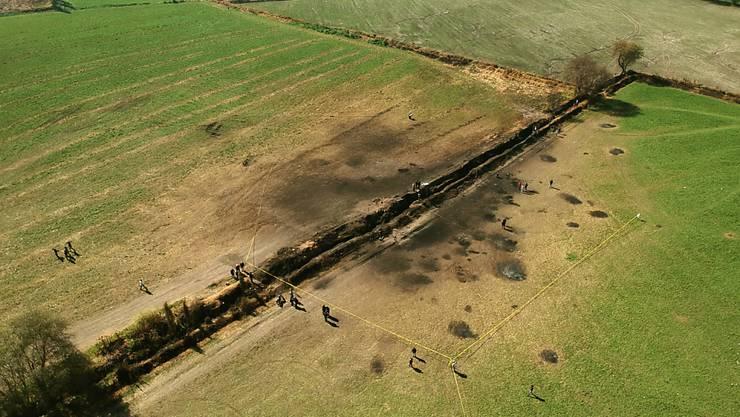 Luftaufnahme von der explodierten Benzinleitung in Mexiko: Über 90 Menschen wurden durch Flammen tödlich verletzt, als sie Benzin aus der lecken Pipeline abzapfen wollten.