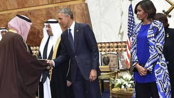 Barack und Michelle Obama bei den Saudis