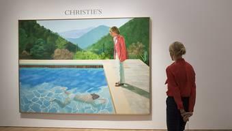"""Der Wert wird auf rund 80 Millionen Dollar geschätzt: das Gemälde des britischen Künstlers David Hockney (81) mit dem Titel """"Portrait of an Artist (Pool with Two Figures)""""."""