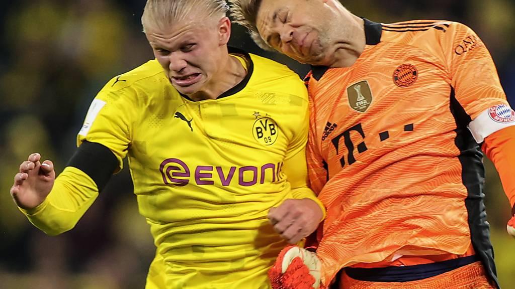 Harter Kampf auch im Supercup: Dortmunds Goalgetter Erling Haaland (links) gegen Goalie Manuel Neuer