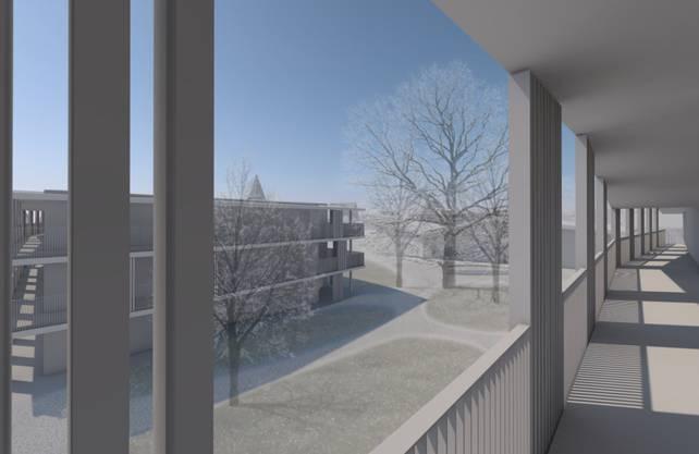 Blick vom Balkon eines der Gebäude des Lindenparks auf den gemeinschaftlichen Aussenraum mit viel Grünfläche.
