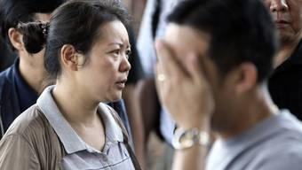 Verwandte eines chinesischen Opfers des Flugzeugabsturzes