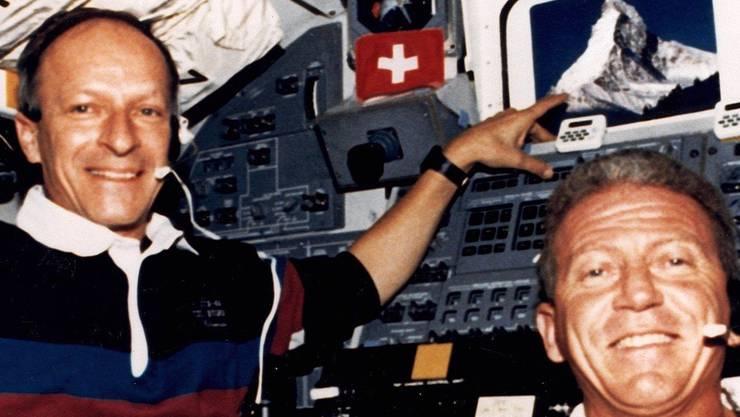 Im All: Claude Nicollier (l.) und Kommandant Loren Shriver.