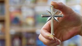 Mit dem Scientology-Kreuz auf Mission. Die Scientologen werben sehr offensiv um Mitglieder.ALESSANDRO DELLA BELLA/Key