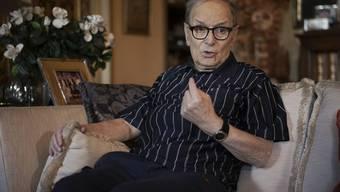 Ennio Morricone hat sich lange genug ausgeruht: Im Herbst will der italienische Komponist und Dirigent wieder auftreten. (Archiv)