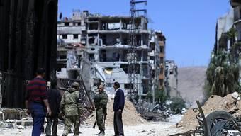Weitgehend zerstört ist die von syrischen und russischen Luftangriffen gezeichnete Stadt Duma nordöstlich von Damaskus (in einer Aufnahme vom Montag, 16. April 2018).