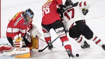Goalie Hiller und Verteidiger Genazzi wehren sich gegen Kanadas Bourque