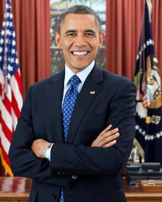 Das Bild zur zweiten Amtszeit: Selbstsicher, lächelnd, Arme verschränkt.