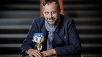 """Sind seit zehn Jahren ein Herz und eine Seele: Der Walliser Animationsfilmer Claude Barras und sein Hauptdarsteller aus """"Ma vie de Courgette"""". (Archivbild)."""
