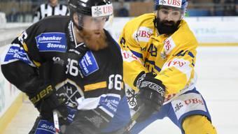 Linus Klasen (Nummer 86), der Torschütze zum 1:0 für Lugano, im Duell der Vollbärte gegen den Davoser Daniel Rahimi.