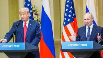 Trump und Putin an Pressekonferenz