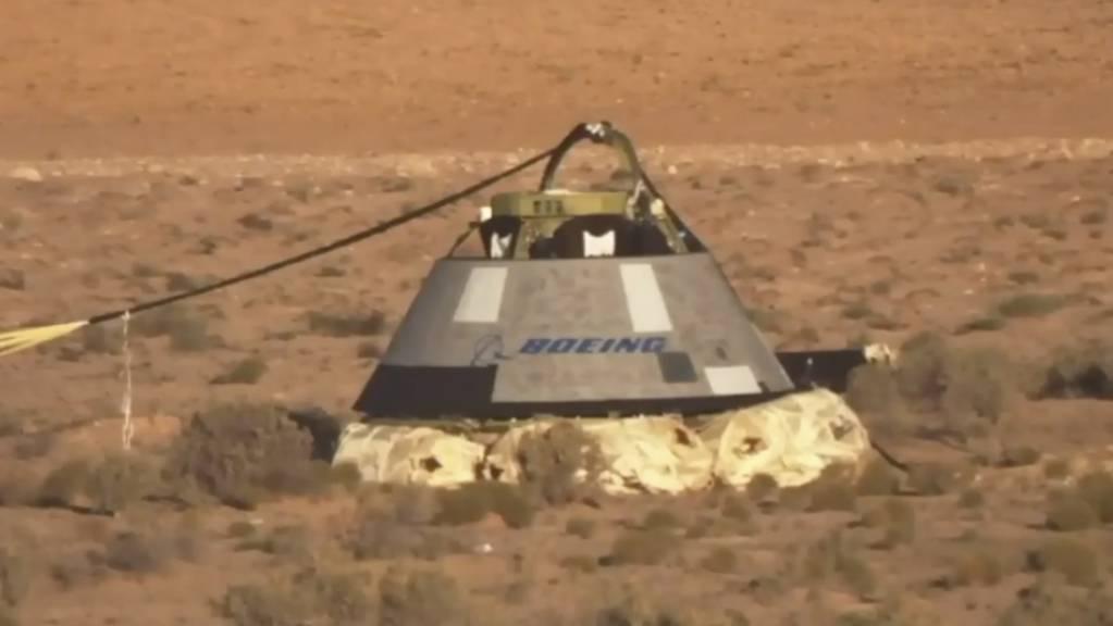 Nach dem gescheiterten Testflug zur ISS ist die unbemannte Boeing-Raumkapsel «Starliner» zur Erde zurückgekehrt.  (NASA via AP)