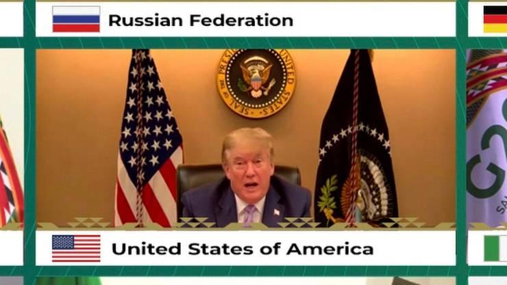 HANDOUT - Donald Trump, US-Präsident, und weitere Staats- und Regierungschefs der führenden Wirtschaftsnationen (nicht im Bild) nehmen an einer Video-Schalte zum virtuellen G20-Gipfel teil. (Wiederholung mit verändertem Bildausschnitt) Foto: -/G20 Riyadh Summit/AP/dpa - ACHTUNG: Nur zur redaktionellen Verwendung und nur mit vollständiger Nennung des vorstehenden Credits