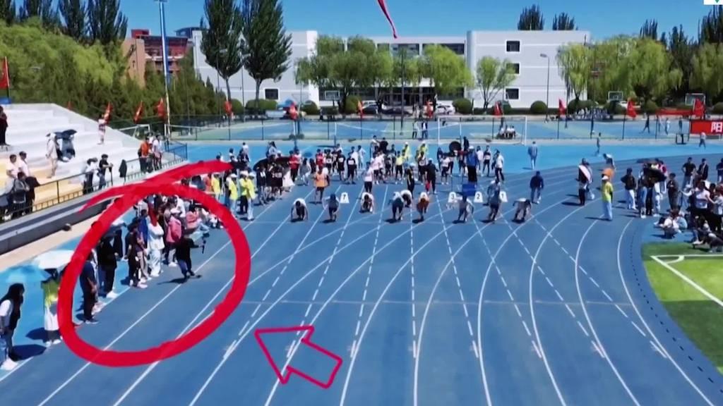 Kameramann lässt Sprinter hinter sich
