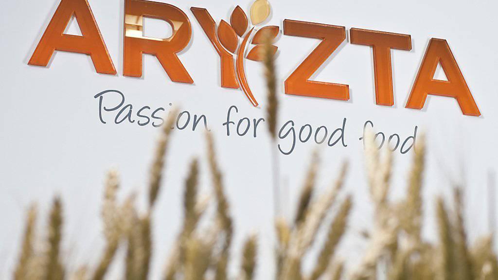 Das Wachstum spriesst nicht gross ins Kraut: Logo von Aryzta hinter Ähren am Firmensitz in Zürich. (Archiv)