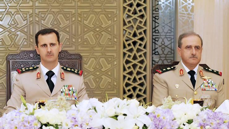 Präsident Bashar Assad (L) und der ermordete Verteidigungsminister Daoud Rajha