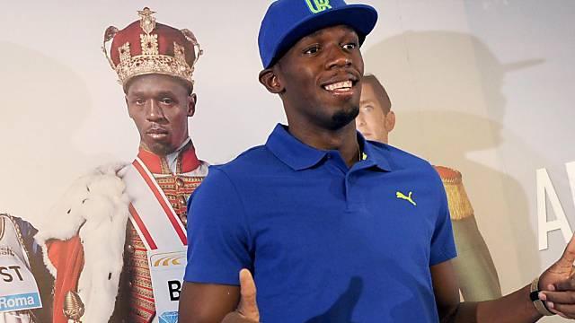 Usain Bolt posiert bei der Pressekonferenz in Rom.