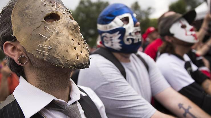 """Maskierte Anhänger der Band Insane Clown Posse, die sogenannte """"Juggalos"""", demonstrieren in Washington"""