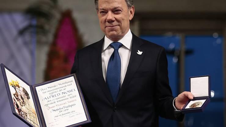 """In seiner Dankesrede sagte Santos, das kolumbianische Volk mache """"mit Unterstützung unserer Freunde aus aller Welt das Unmögliche möglich""""."""