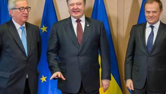 Juncker, Poroschenko und Tusk (v.l.n.r.) am Donnerstag in Brüssel.