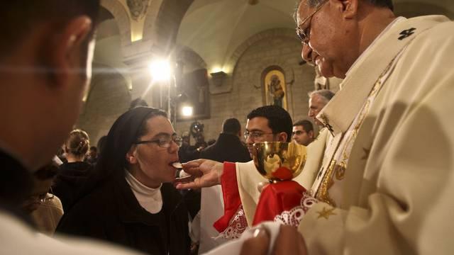 Mitternachtsmesse in Bethlehem: Patriarch Fouad Twal (r.) setzt auf Dialog im Nahen Osten