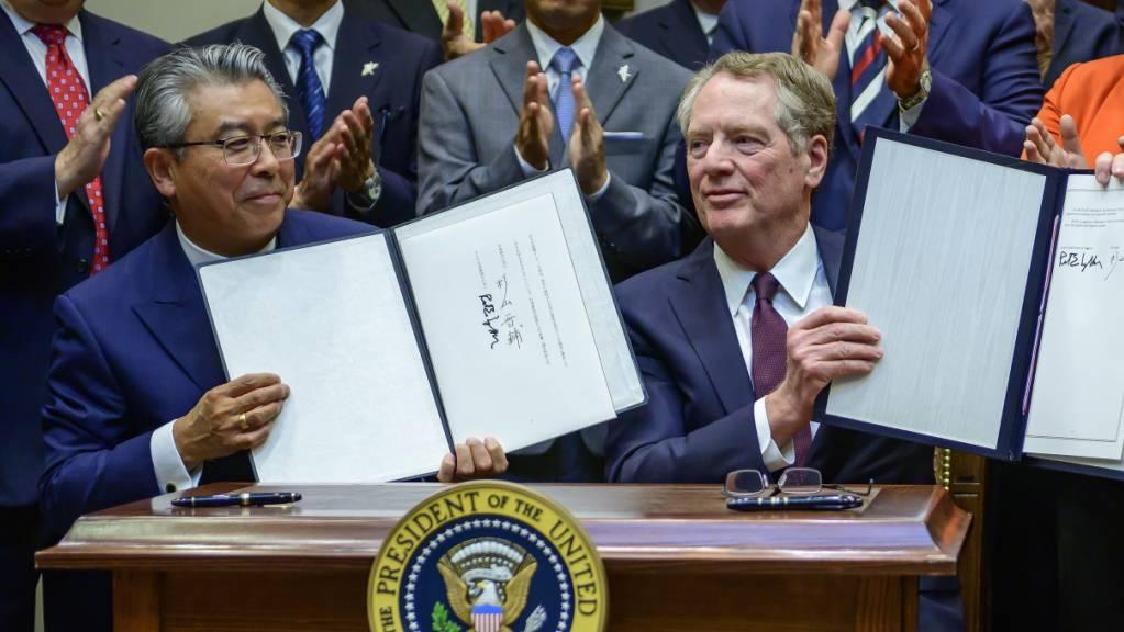 Die USA und Japan haben am Montag (Ortszeit) zwei Handelsabkommen in den Bereichen Landwirtschaft und Digitales unterzeichnet.