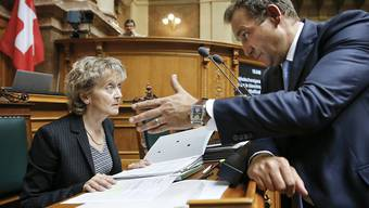 Thomas Matter (SVP/ZH) und Finanzministerin Eveline Widmer-Schlumpf sind sich nicht einig, wenn es um das Bankgeheimnis geht.