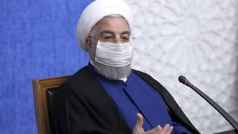 HANDOUT - Hassan Ruhani, Präsident des Iran, hat die Bereitschaft seines Landes für eine Zusammenarbeit mit US-Wahlsieger Joe Biden signalisiert. Foto: Uncredited/Office of the Iranian Presidency/AP/dpa - ACHTUNG: Nur zur redaktionellen Verwendung im Zusammenhang mit der aktuellen Berichterstattung und nur mit vollständiger Nennung des vorstehenden Credits
