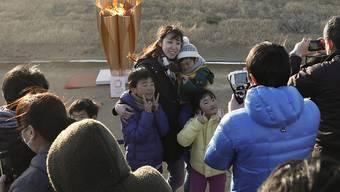 Das olympische Feuer sorgte in Japan für einen Zuschaueraufmarsch