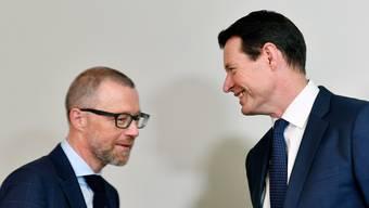 Heinz Huber, links, CEO Raiffeisen, und VR-Präsident Guy Lachappelle, rechts, an der ersten gemeinsamen Bilanzmedienkonferenz im März 2019.