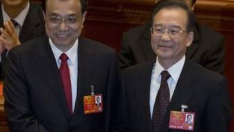 Chinas neuer Premier Li Keqiang (links) mit seinem Vorgänger Wen Jiabao