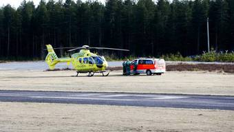 Helikopter und Ambulanz am Absturzort in Jämijärvi