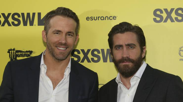 "Ryan Reynolds, left, and Jake Gyllenhaal arrive for the world premiere of ""Life"" at the ZACH Theatre during the South by Southwest Film Festival on Saturday, March 18, 2017, in Austin, Texas. (Photo by Jack Plunkett/Invision/AP)"