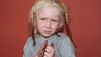Das vierjährige Mädchen auf einem Polizeibild
