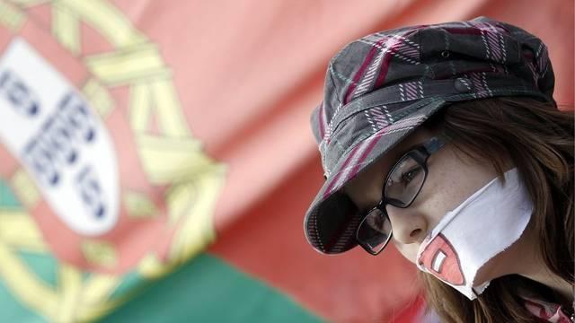 Eine Demonstrantin protestiert in Bern