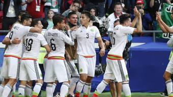 Die Mexikaner feiern gegen Portugal ihren späten Ausgleichstreffer